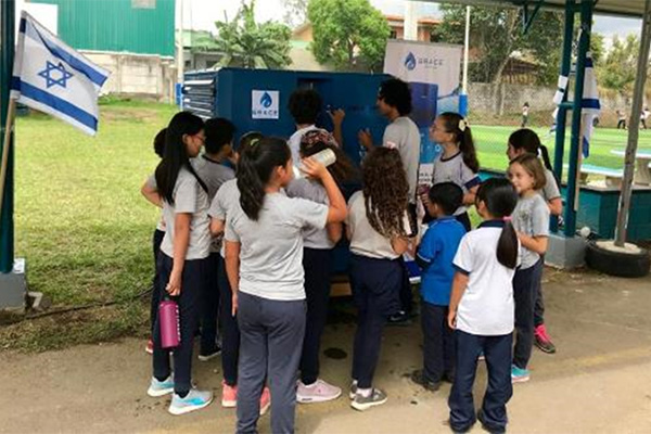 Costa Rica school students drinking from a Gen -M