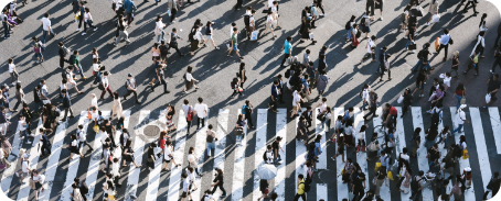 Many people crossing a road